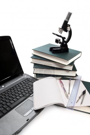 Photo for Laptop, microscope, books and others tools for university education. - Royalty Free Image