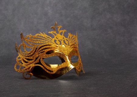 Decorated mask for masquerade on dark background