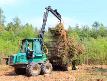 Tractor collecting haystack