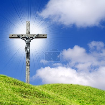 Photo for Shining cross into spring landscape - Royalty Free Image
