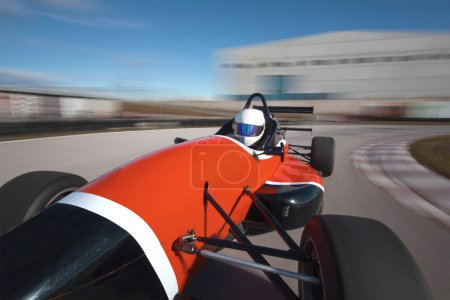 Red bolide driving at high speed in circuit.Camera on board view