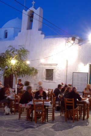 Taverna at night by church