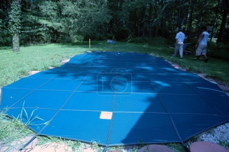Photo for Installation of pool cover - Royalty Free Image