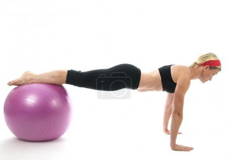 Strength pose middle age woman fitness core ball