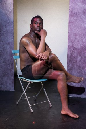 Handsome male black african american actor on theater stage with