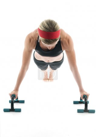woman exercising doing push up with fitness push up bar front