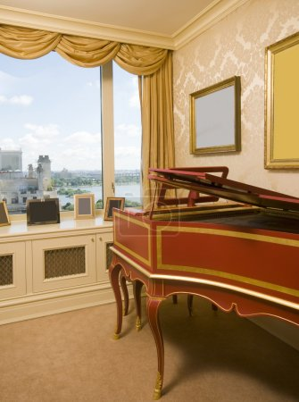 harpsichord in penthouse bedroom with river view in new york cit