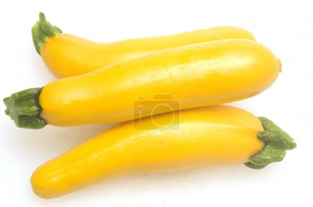 three yellow zucchini squash with slices