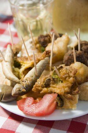 Plate of mezes appetizers wine Greek food