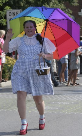 A person dressed as Dorothy from Wizard of The Oz greets at Indy Pride