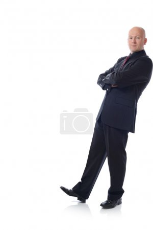 man in suit leaning