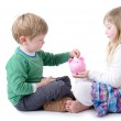 Big sister teaching little brother to save for a r...