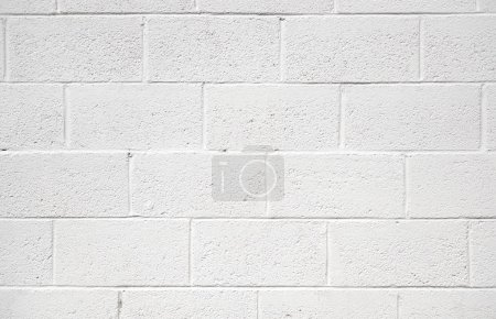 White painted concrete block wall background textu...