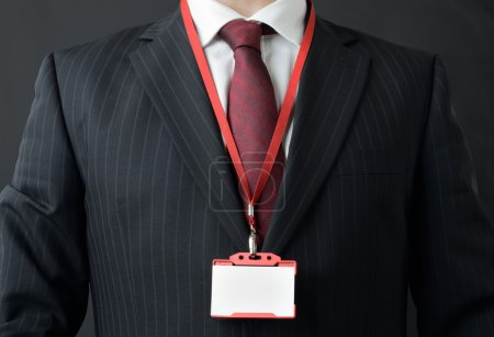 Photo for Man in suit showing id or name badge - Royalty Free Image