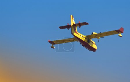 Fire fighting plane going on its mission