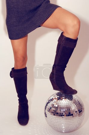 woman stands on glitterball
