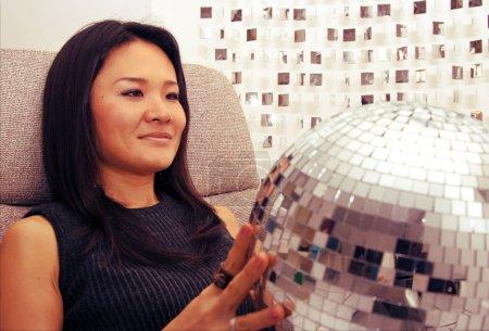 japanese woman holds glitterball