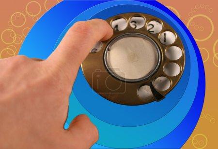 Photo pour La bague de cadran découpée à partir d'un vieux téléphone de style rétro pour créer un motif funky - image libre de droit