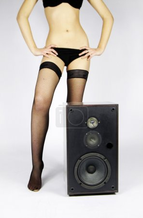 Photo for A sexy female in lingerie behind a hifi speaker - Royalty Free Image