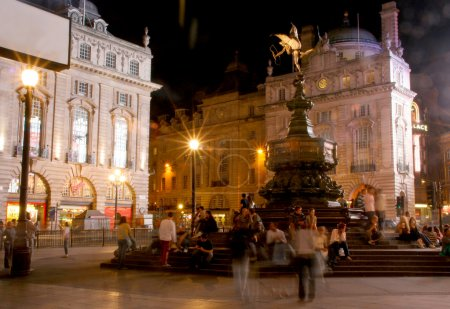 Crowds at night around the Eros statue