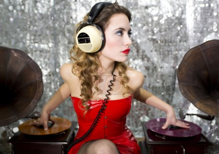 Beautiful disco dj with gramophones
