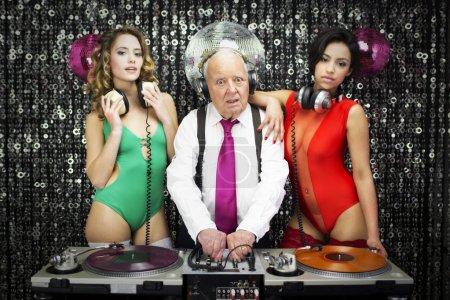 grandpa DJ and two beauitful gogo dancers