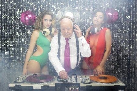 Grandpa DJ and two beautiful gogo dancers