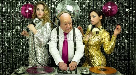 Grandpa DJ and gogo dancers