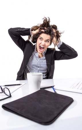 Stressed business woman screaming and pulling hair