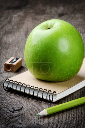 Green apple and school supplies