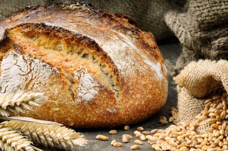 Photo for Freshly baked traditional bread on the wooden table - Royalty Free Image