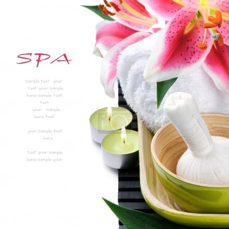 Spa setting with candles and pink lily