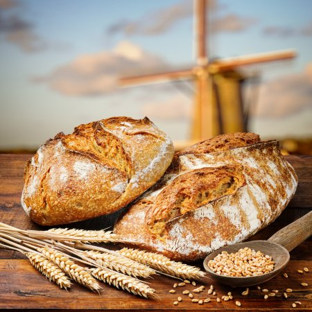 Photo for Freshly baked traditional bread on wooden table - Royalty Free Image