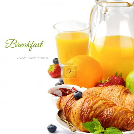Photo for Breakfast with orange juice and fresh croissants isolated over white - Royalty Free Image