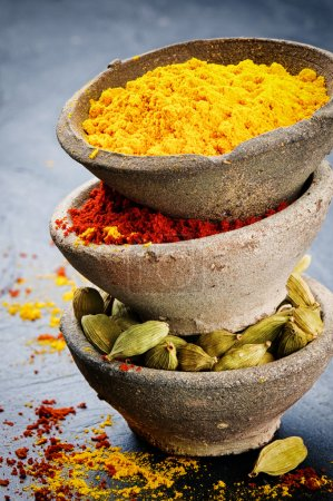 Photo for Stack of colorful mix of spices on stone background - Royalty Free Image