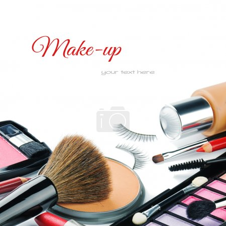 Photo for Colorful make-up products isolated over white - Royalty Free Image