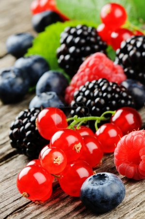 Photo for Fresh organic berries on wooden table - Royalty Free Image