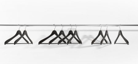 Photo for Black clothes hangers on white background. studio light - Royalty Free Image