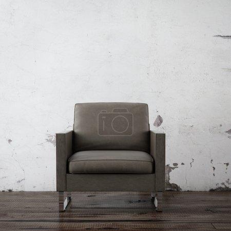 Foto de Sillón en la sala vacía con muro de hormigón - Imagen libre de derechos