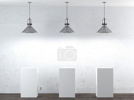 Three white stands in interior