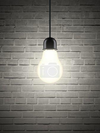 Lightbulb on brick wall