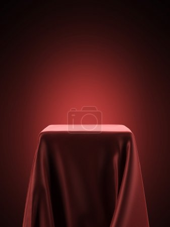 Pedestal covered with red cloth isolated on a red ...