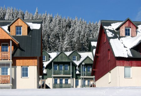 Photo for Snow-covered ski resort hotels in the Czech mountains - Royalty Free Image