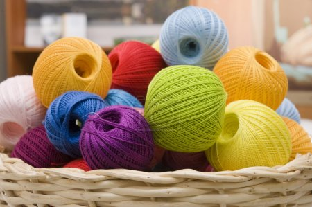 Colorful wool's balls in a basket...