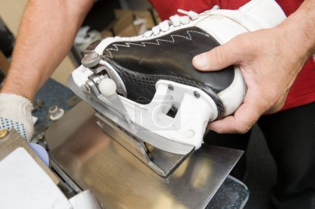 Photo for Service for skate with adept repairing skates - Royalty Free Image