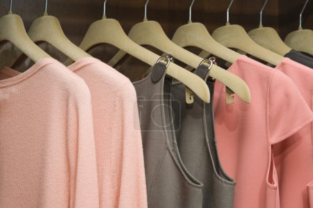 Photo for Colorful collection of women's clothes hanging on a rack - Royalty Free Image