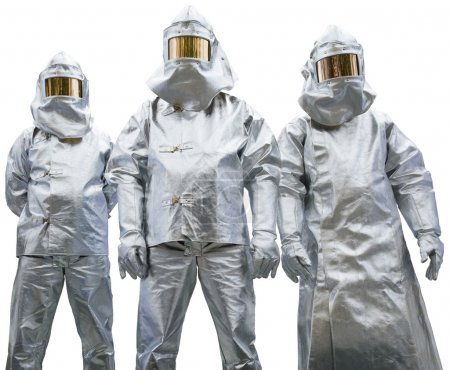 Three workers in protective clothing