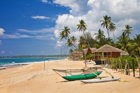 Tropical solitude - beach scene with boat. Sri lanka