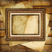 Vintage background from old papers and blank antique frame