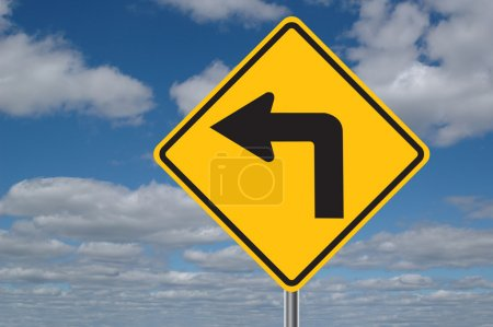 Left Turn Sign with Clouds